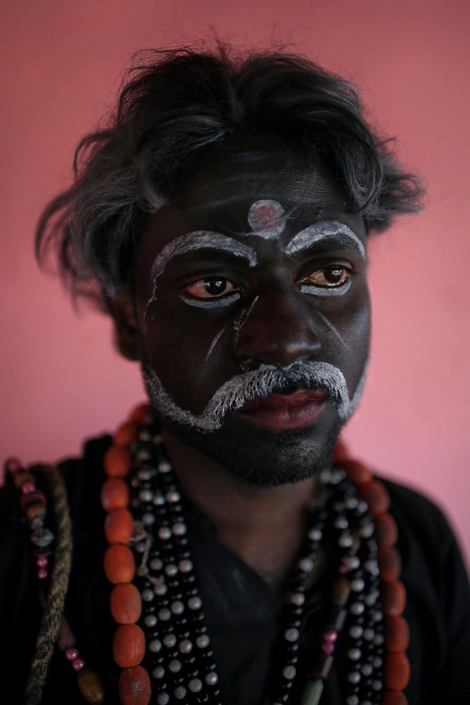 A dancer from the Gaarudi Gombe Kunitha tradition playing the evil demon Ravan, poses for a portrait in Karnataka. (Photo: Souvid Datta)