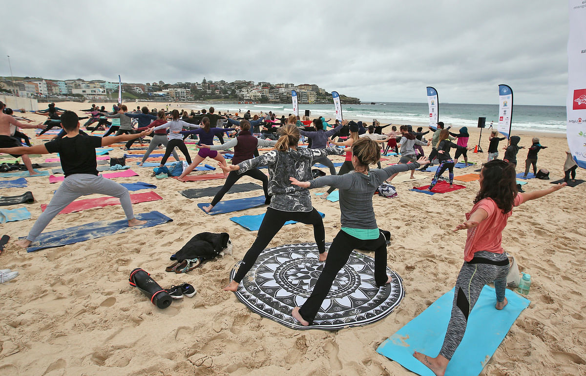 Participants strike a pose during an event to mark International Yoga Day. (Photo: AP)