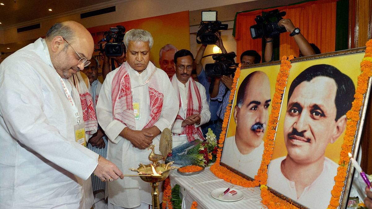 BJP  President Amit Shah lighting a  lamp to inaugurate party's  national executive meeting in Allahabad, 12 June 2016. (Photo: PTI)