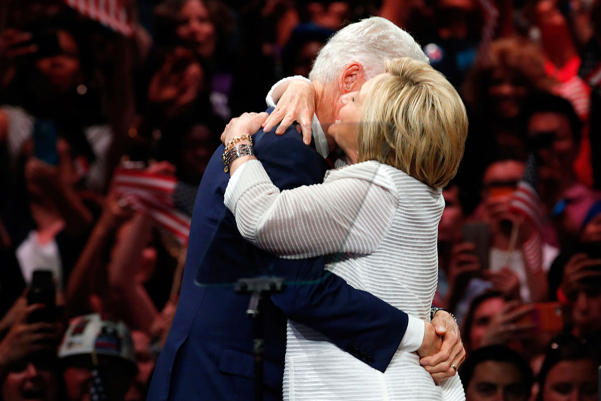 Former President Bill Clinton hugs his wife and Democratic presidential candidate Hillary Clinton, after she spoke during a presidential primary election night rally, Tuesday, 7 June 2016. (Photo: AP)