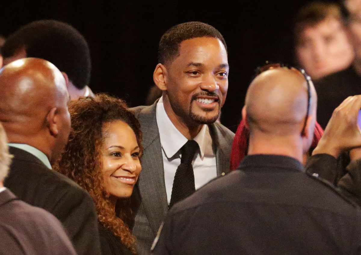 Actor Will Smith arrives with his wife Jada Pinkett for Muhammad Ali's memorial service, Friday, June 10, 2016, in Louisville, Ky. (AP Photo/David Goldman)