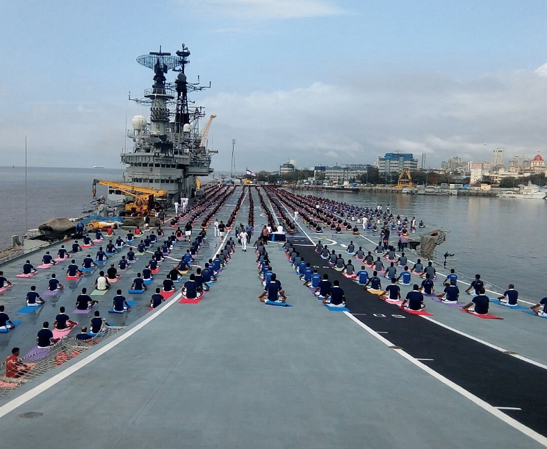 Navy personnels doing yoga onboard aircraft carrier INS Viraat. (Photo: ANI)