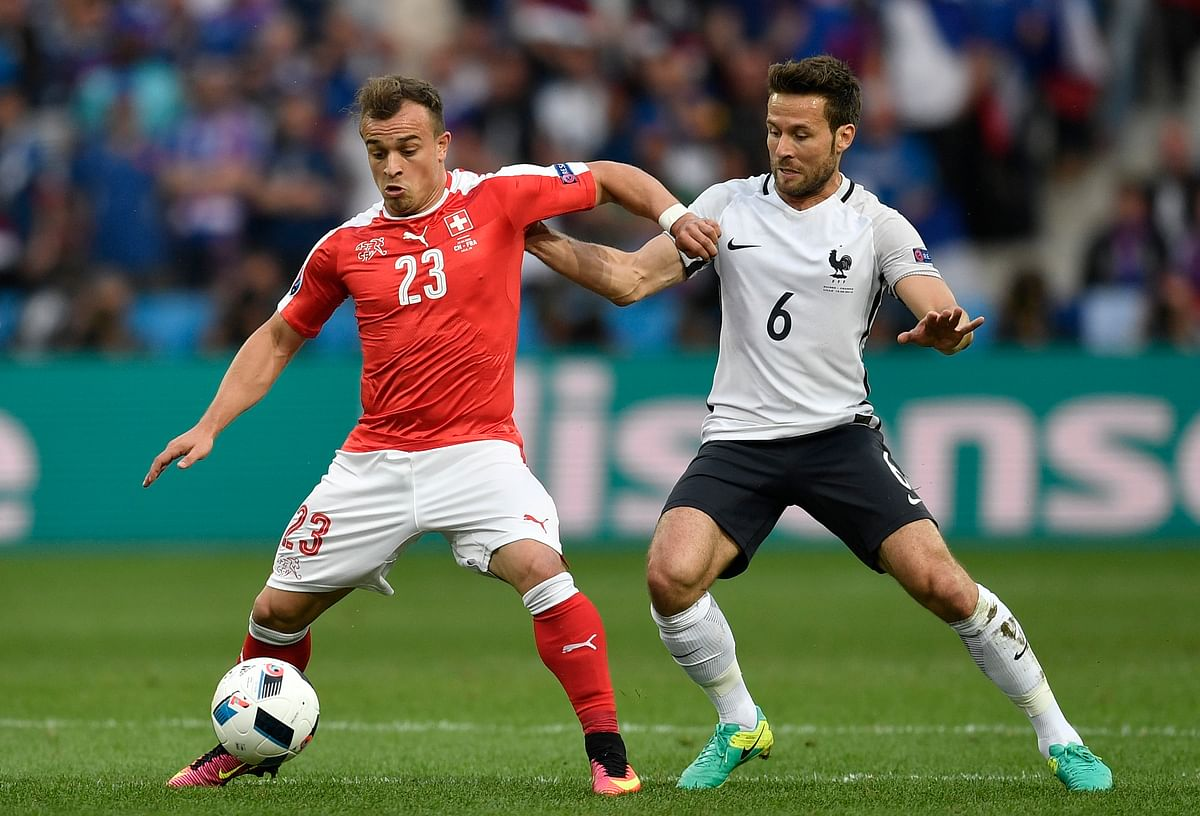 Switzerland's Xherdan Shaqiri, left, fights for the ball with France's Yohan Cabaye during their group match. (Photo: AP)