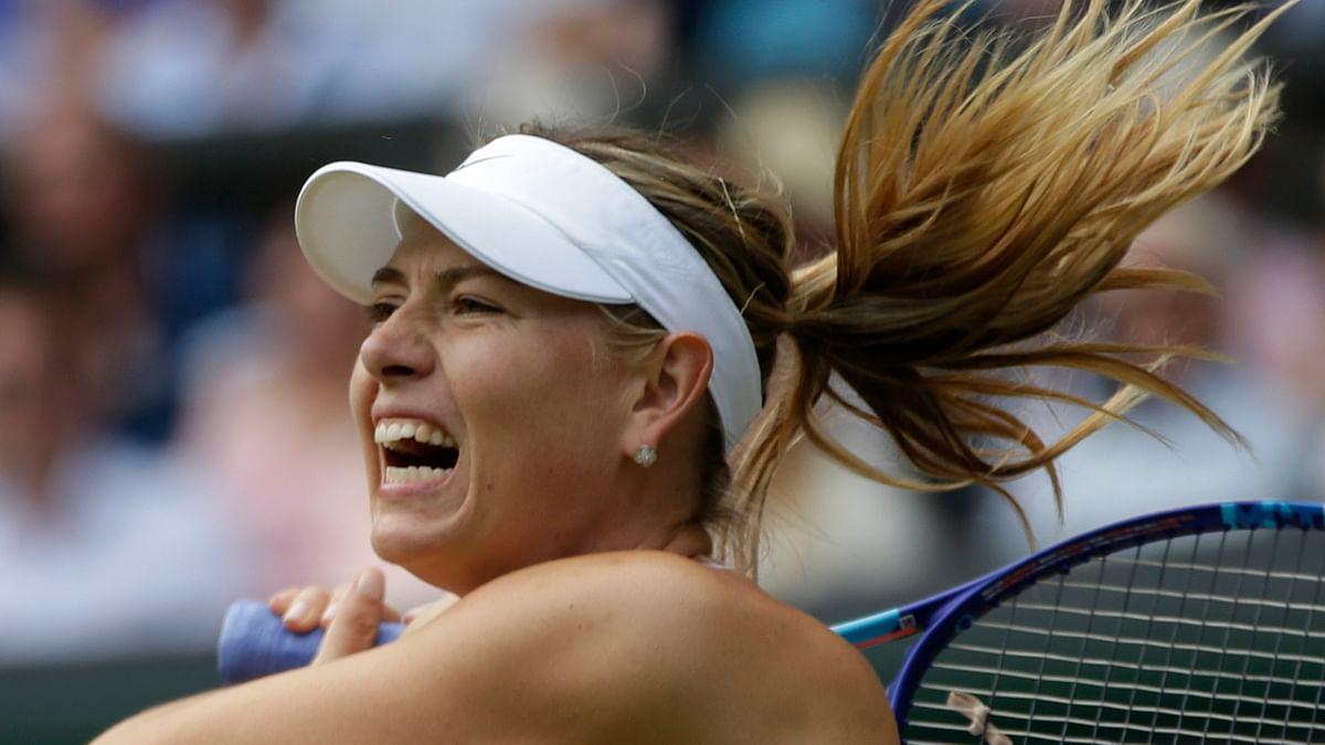 Maria Sharapova returns a shot during a quarterfinal. (Photo: AP)