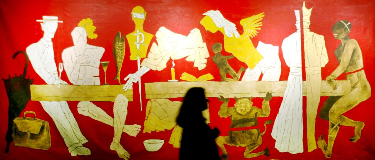 A visitor looks at a painting by MF Husain during an exhibition in Mumbai.