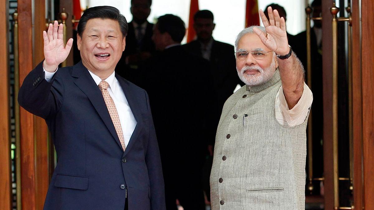 Prime Minister Narendra Modi (R) and China's President Xi Jinping. (Photo: Reuters)