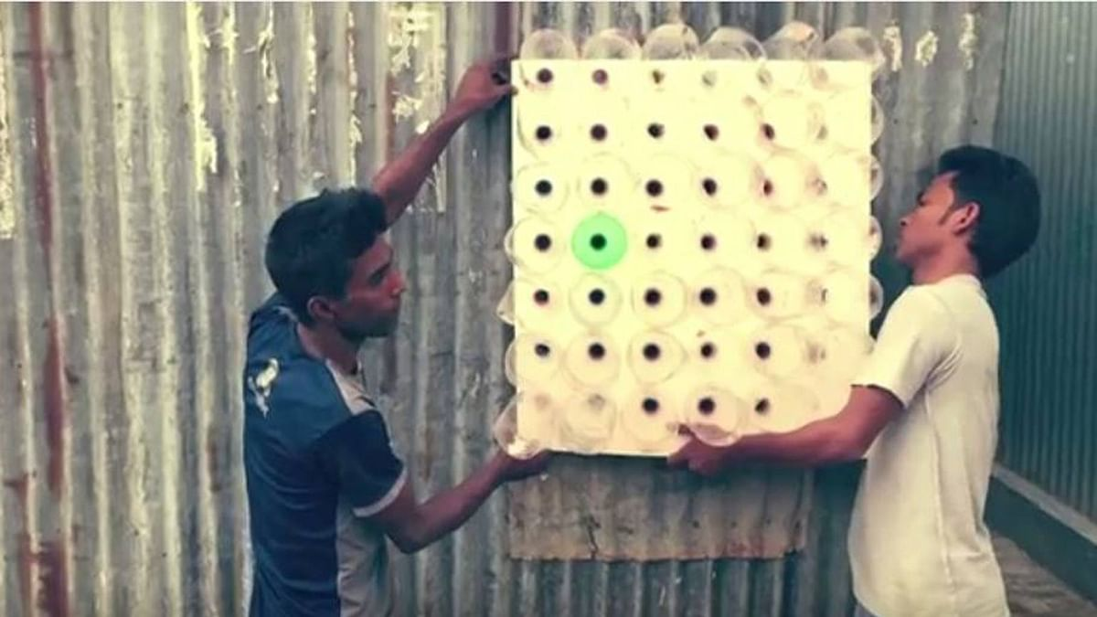 People mounting an Eco Cooler on a vent. (Photo Courtesy: YouTube Screengrab)