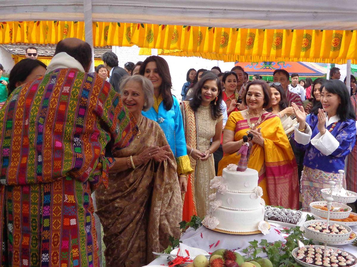 The bridal party around the wedding cake (Photo courtesy: Bhawana Somaaya)
