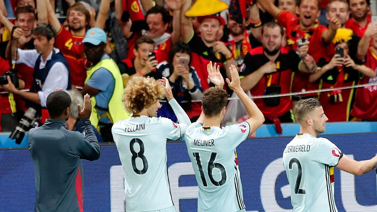 Belgium's players acknowledge their fans at the end the Euro 2016 round of 16  match between Hungary and Belgium (Photo: AP)