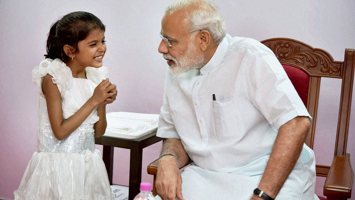 Prime Minister Narendra Modi interacts with Vaishali whose heart surgery was funded by the PMO after she wrote to him seeking help, in Pune, June 26, 2016. (Photo: PTI)