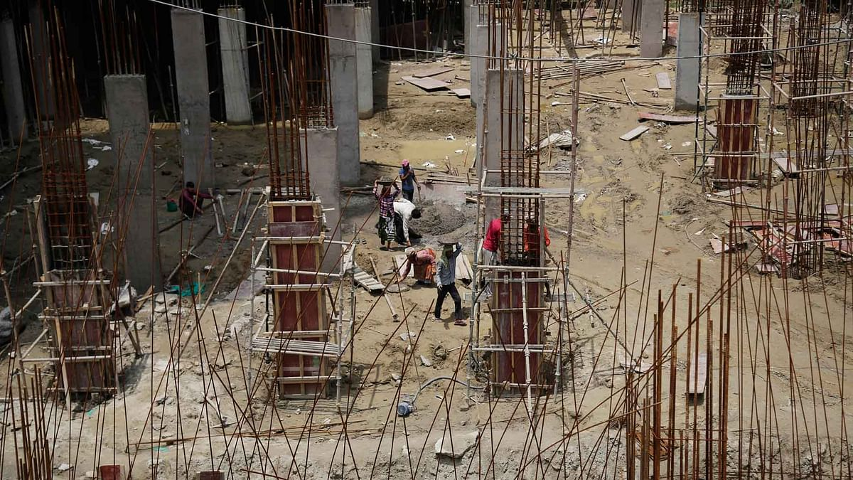 Laborers work at a construction site in Noida. ( Photo: AP)