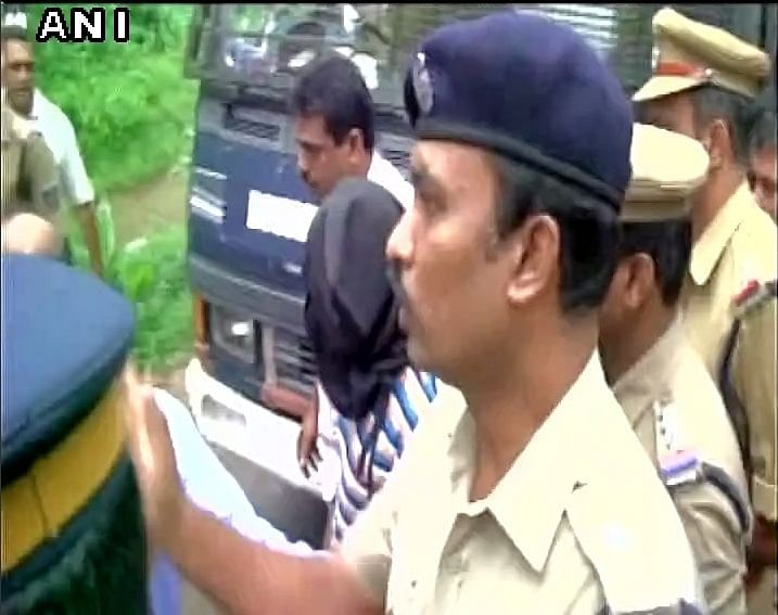 Accused in the Jisha rape and murder case escorted by police. (Photo: ANI)