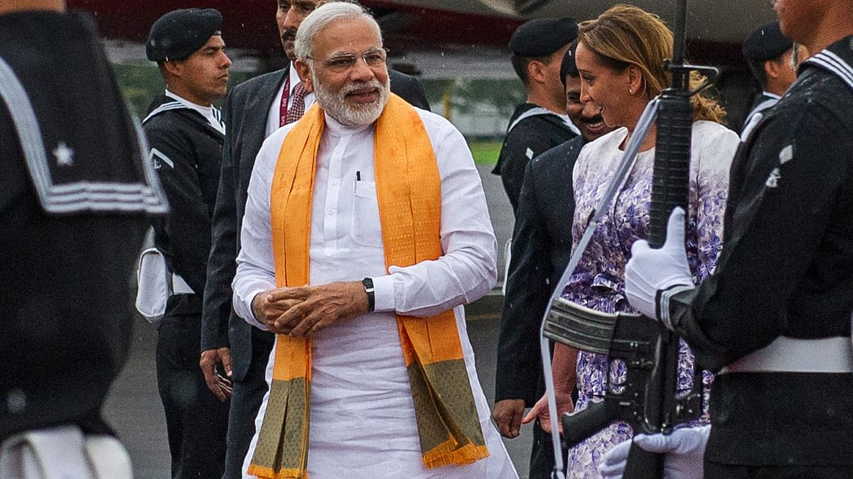Narendra Modi being received by Mexican Secretary of Foreign Affairs, Claudia Ruiz Massieu, after landing at the Benito Juarez International Airport in Mexico City on 8 June. (Photo: AP)