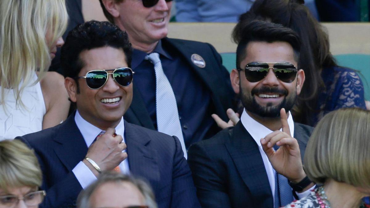 Sachin Tendulkar and Virat Kohli at Wimbeldon on 10 July 2015. (Photo: AP)