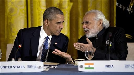President Barack Obama talks with Prime Minister Narendra Modi during a working dinner with heads of delegations of the Nuclear Security Summit. (Photo: AP)