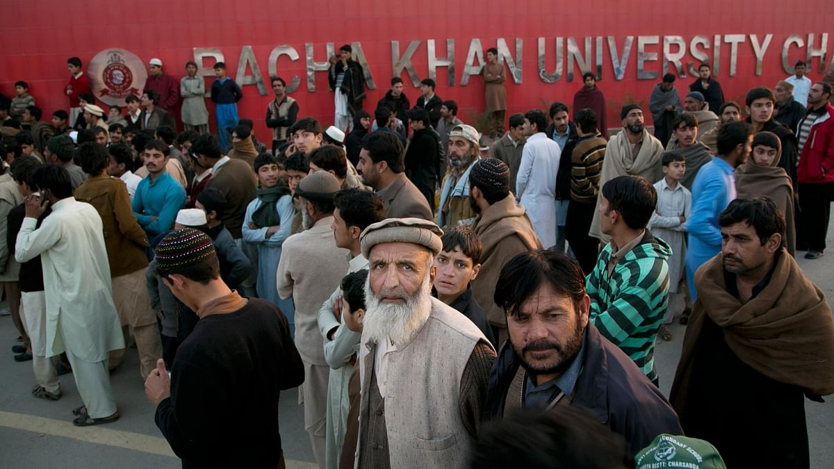 Family members of students stand outside the Bacha Khan University in Charsadda town, some 35 kilometers outside the city of Peshawar, Pakistan. (Photo: AP)