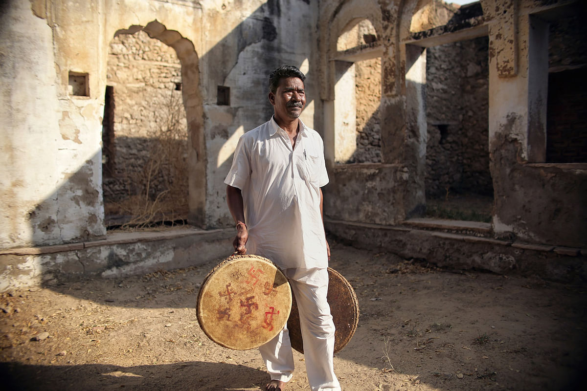 A rural musician holds up traditional Nagarra drums in Savatri village, Rajasthan. (Photo: Souvid Datta)