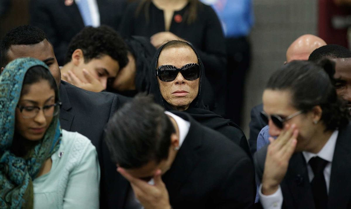 Muhammad Ali's wife Lonnie (centre) attends Muhammad Ali's Jenazah, in Freedom Hall, Thursday, June 9, 2016, in Louisville, Kentucky. (Photo: AP)