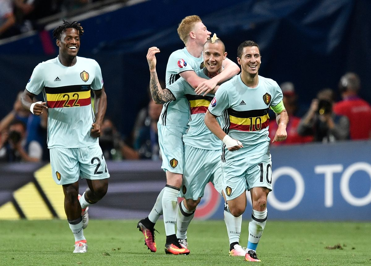 Belgium's Eden Hazard, right, celebrates with team mates after scoring his side's third goal during the Euro 2016 round of 16 match between Hungary and Belgium. (Photo: AP)