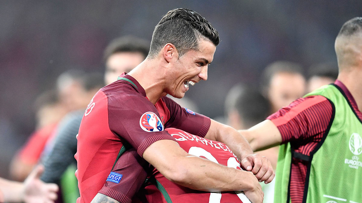 Portugal's Cristiano Ronaldo celebrates with his teammate Ricardo Quaresma after winning the Euro 2016 quarterfinal soccer match between Poland and Portugal. (Photo: AP)