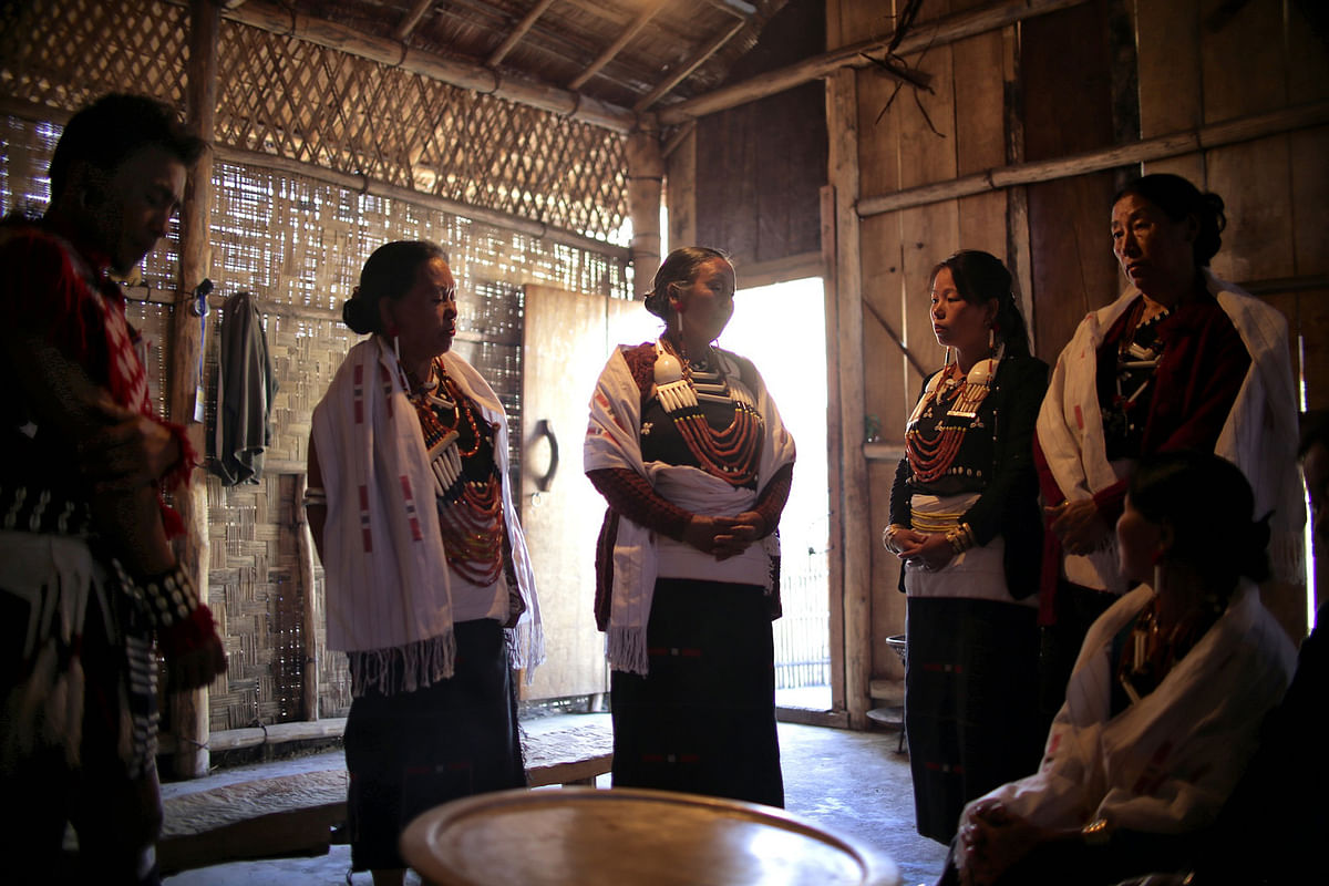 Members of the Rengma tribe sing a traditional song sung by mothers when her sons leave for battle, in their 'Morong' at the annual Hornbill Festival.  (Photo: Souvid Datta)