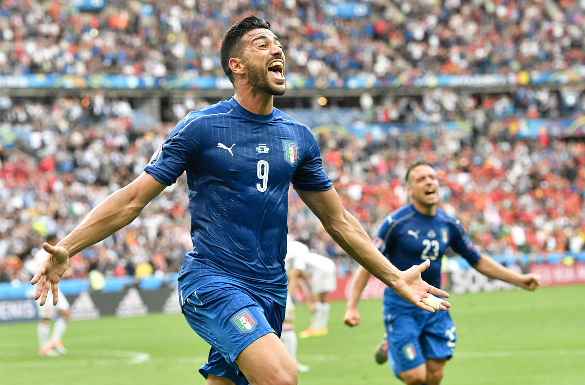 Italy's Graziano Pelle celebrates after scoring his side's second goal. (Photo: AP)