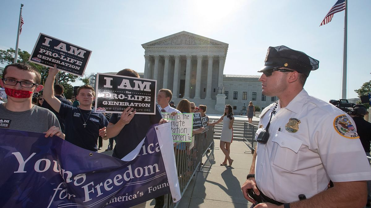 Protesters outside the Supreme Court on Monday. (Photo: AP)
