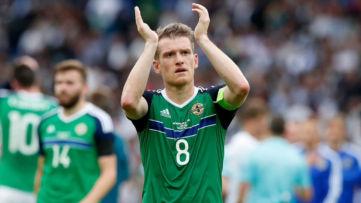 Northern Ireland's Steven Davis applauds at the end of their match against Germany. (Photo: AP)