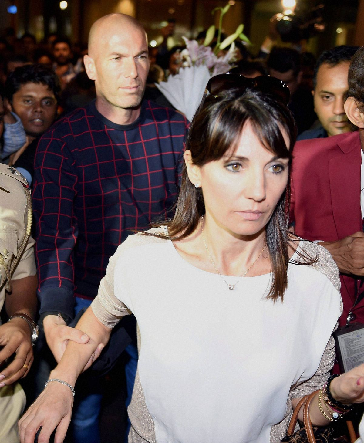 French footballer Zinedine Zidane with his wife Véronique Zidane at the International airport in Mumbai on Thursday. (Photo: PTI)