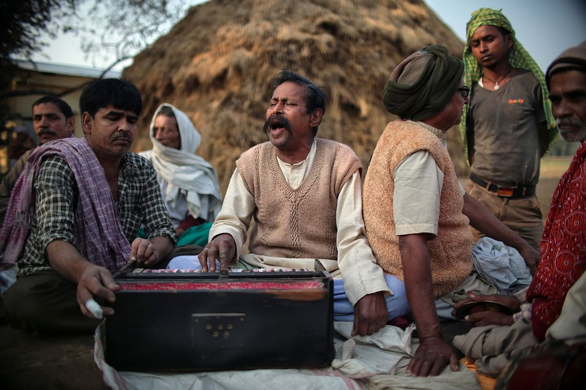 A singer performs traditional Baul songs in a village in Uttar Pradesh.  (Photo: Souvid Datta)