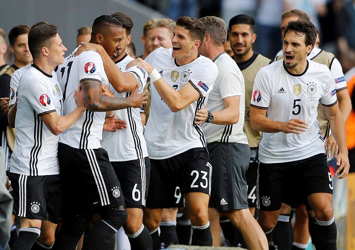 Germany's Jerome Boateng celebrates with teammates after scoring his side's first goal during the Euro 2016 round of 16 match between Germany and Slovakia. (Photo: AP)