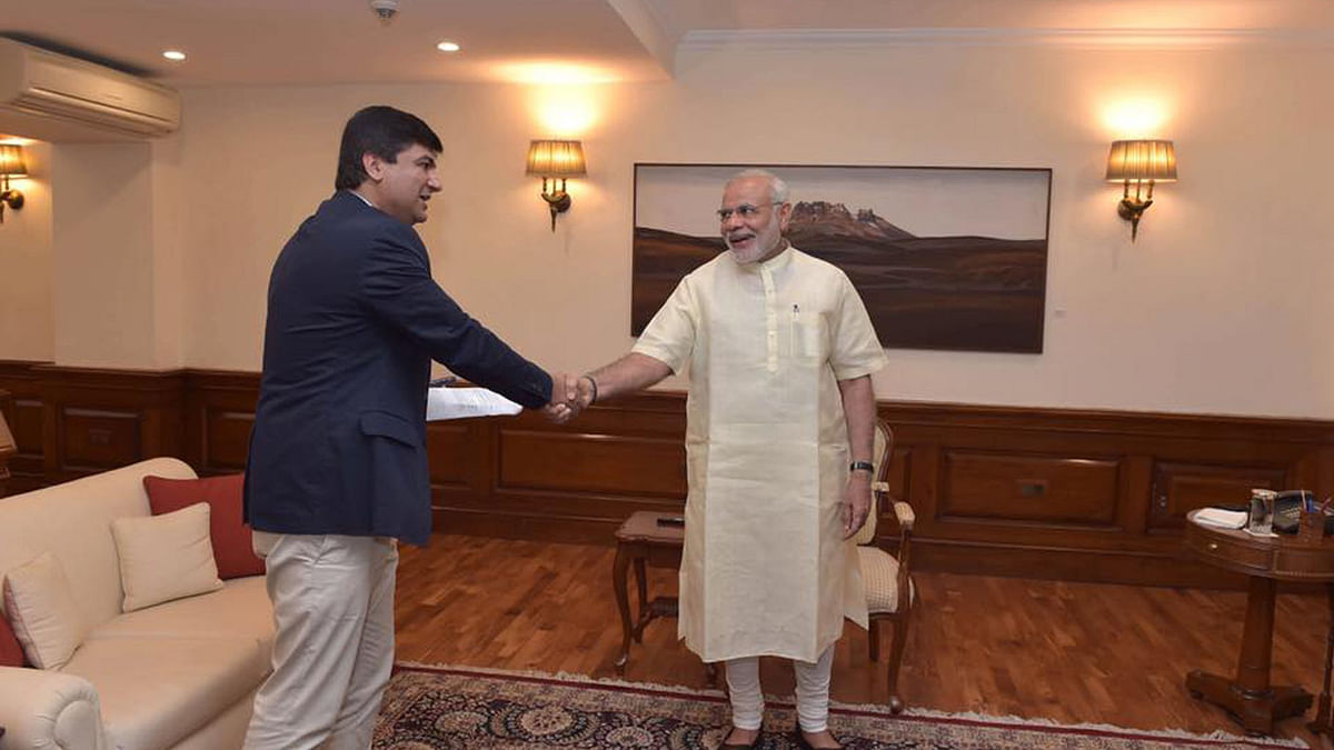 """Journalist Bobby Naqvi with Indian Prime Minister Narendra Modi. (Photo Courtesy: <a href=""""https://www.facebook.com/bobby.naqvi/posts/10153895254152830"""">Bobby Naqvi's Facebook page</a>.)"""