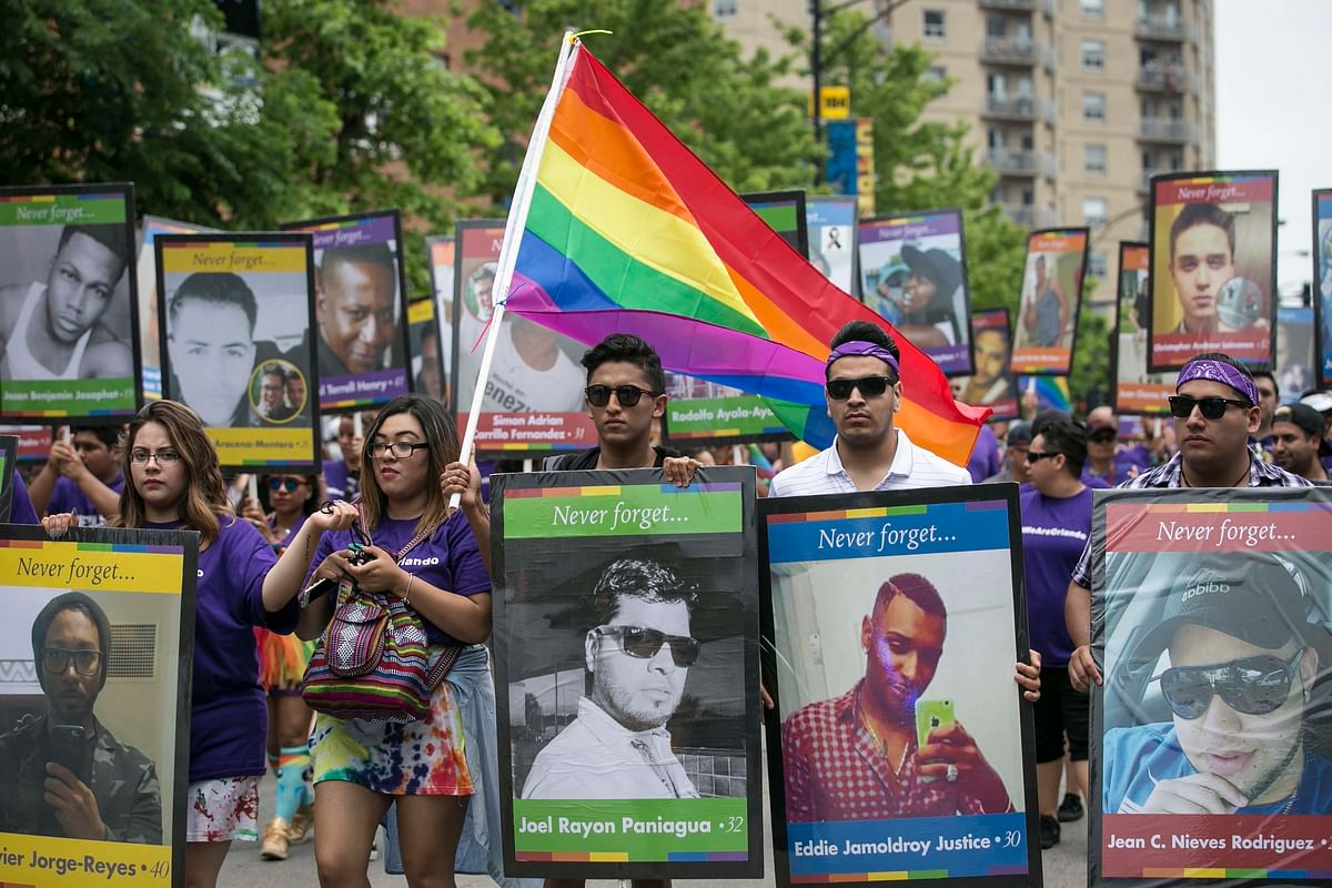 A group carried placards with photos of the Orlando victims. (Photo: AP)