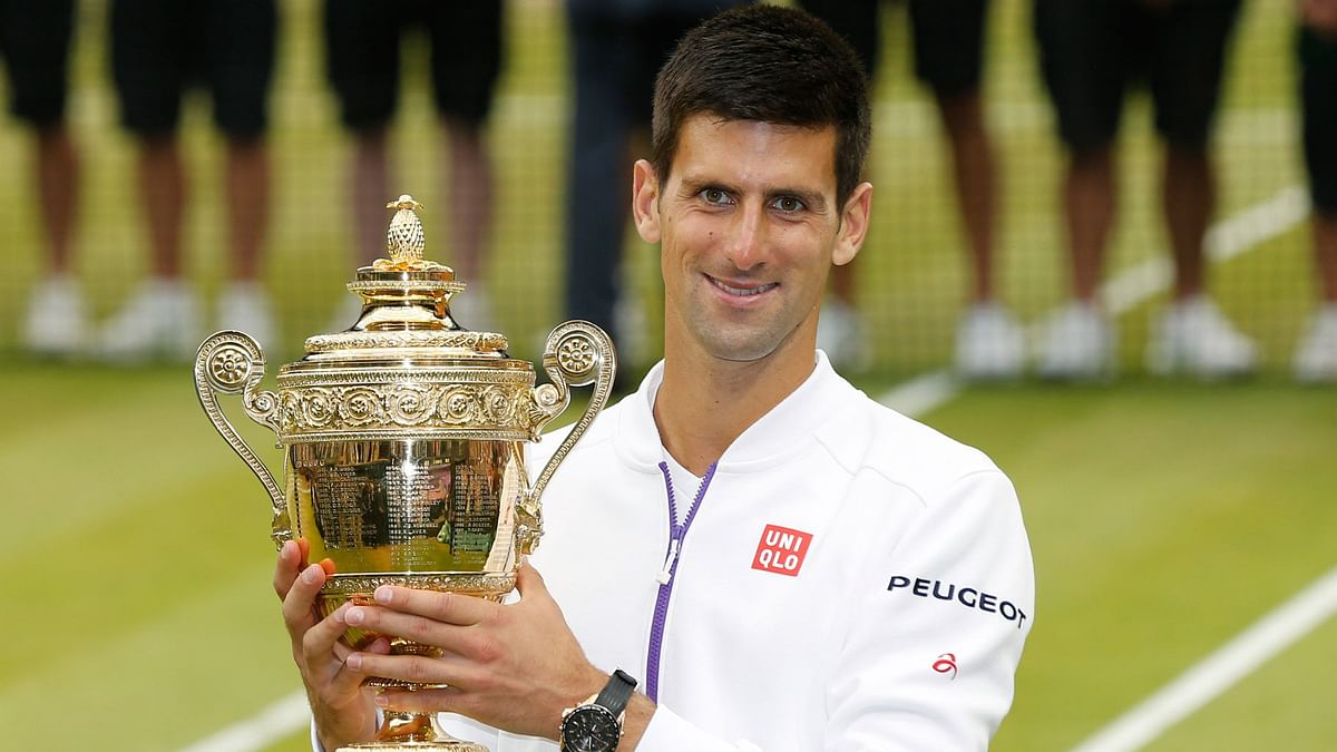 Novak Djokovic holds the trophy after winning Wimbledon in 2015. (Photo: Reuters)