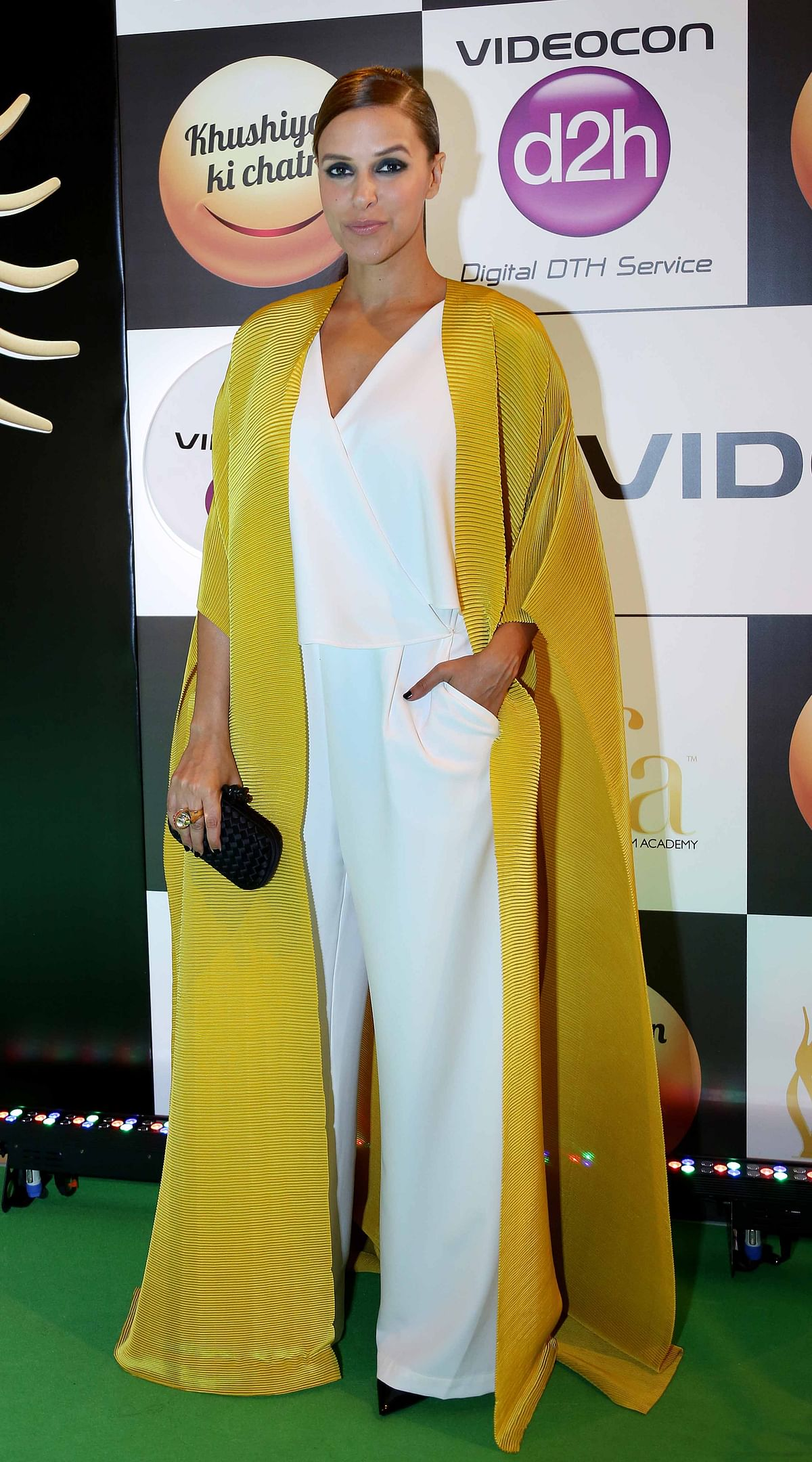 Neha Dhupia paired her Marks & Spencer 'Separates' outfit with a flowy  Payal Khandwala cape. ( Photo: Yogen Shah)