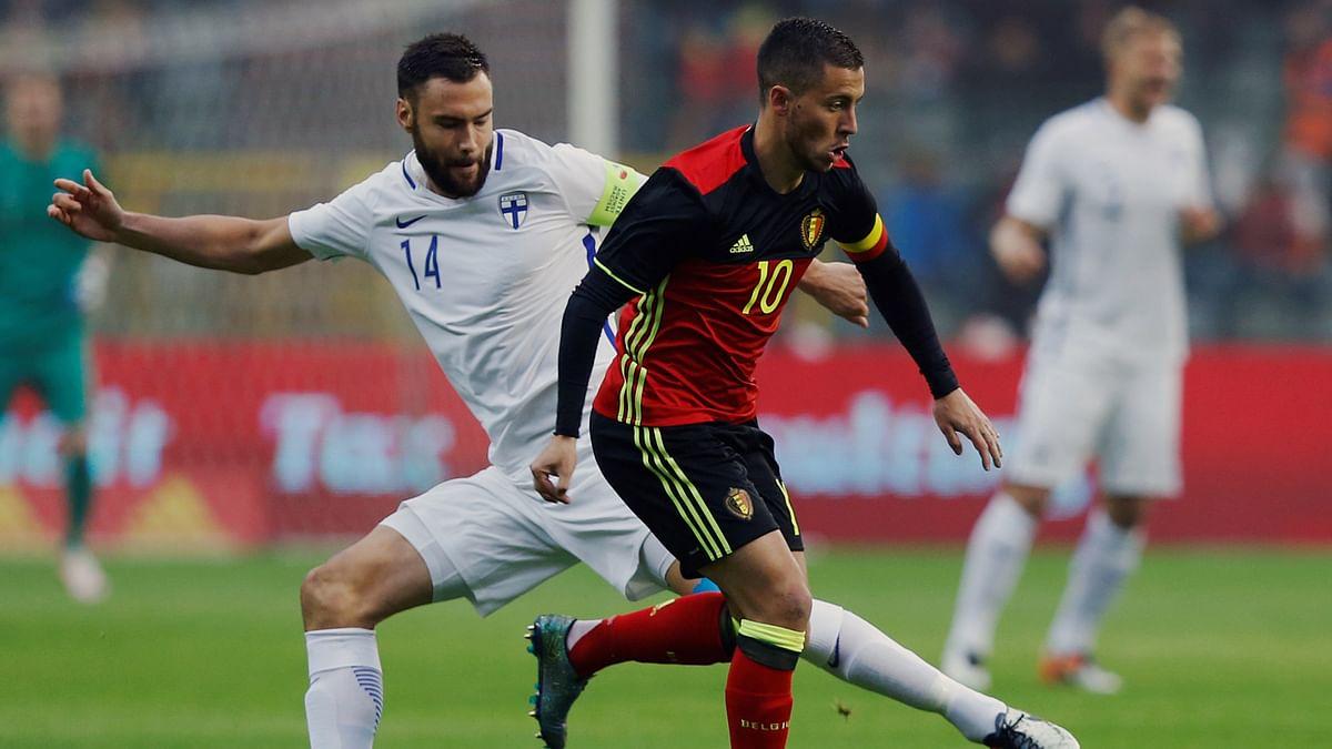Belgium's Eden Hazard (R) in action with Finland's Tim Sparv during a friendly game. (Photo: Reuters)
