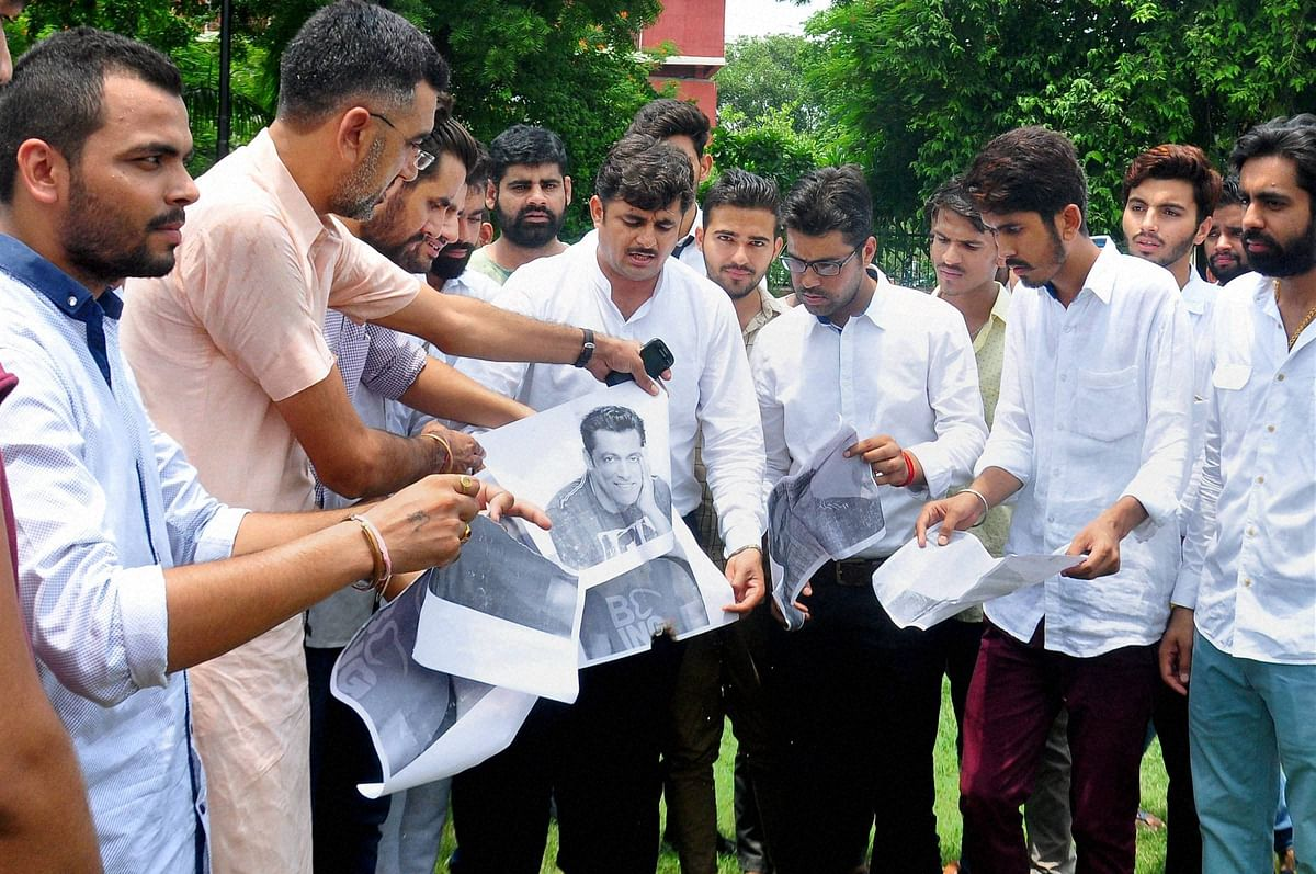 Members of the Bishnoi community burn photographs of  Salman Khan in protest against  the chinkara poaching case in which he was also acquitted. (Photo: PTI)