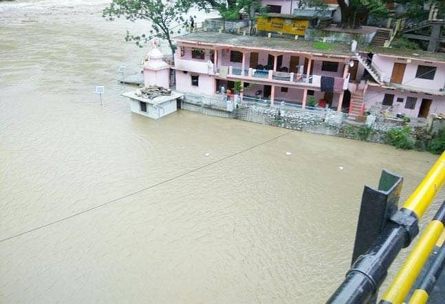 River Alaknanda has risen above the danger level mark after a cloudburst in Chamoli district. (Photo: ANI)