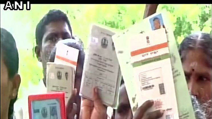 Dalit families return their voter and aadhar card. (Photo: ANI)