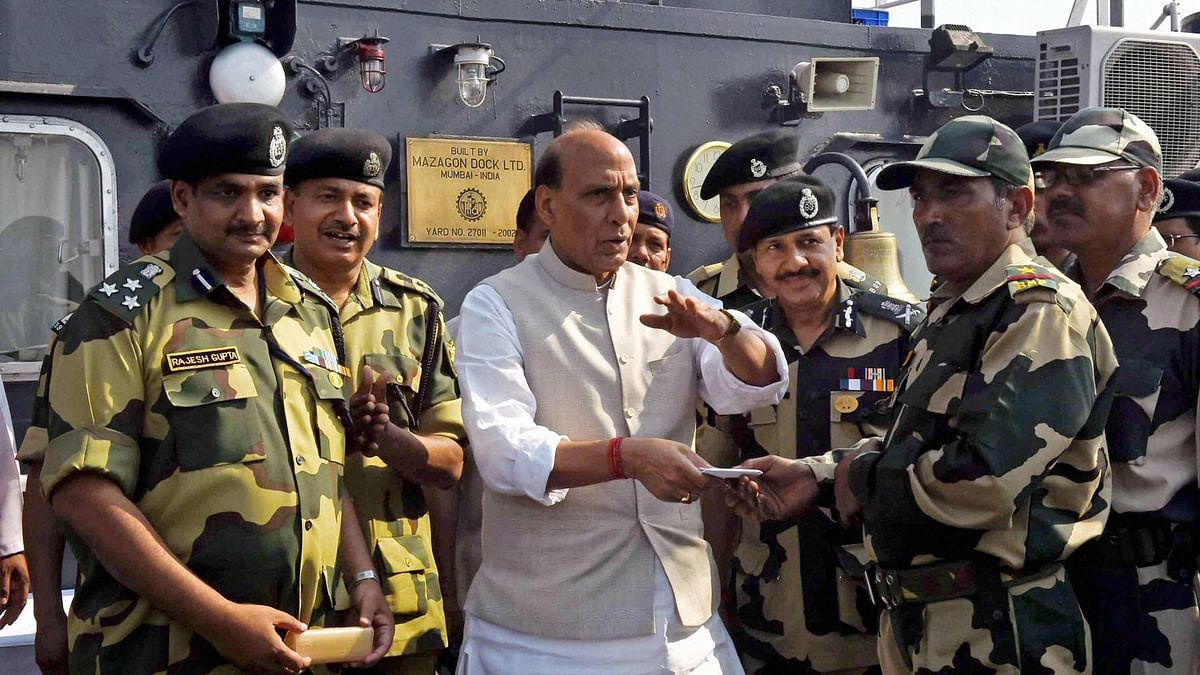 Union Home Minister Rajnath Singh with BSF personnel at a Border Out Post. (Photo: PTI)