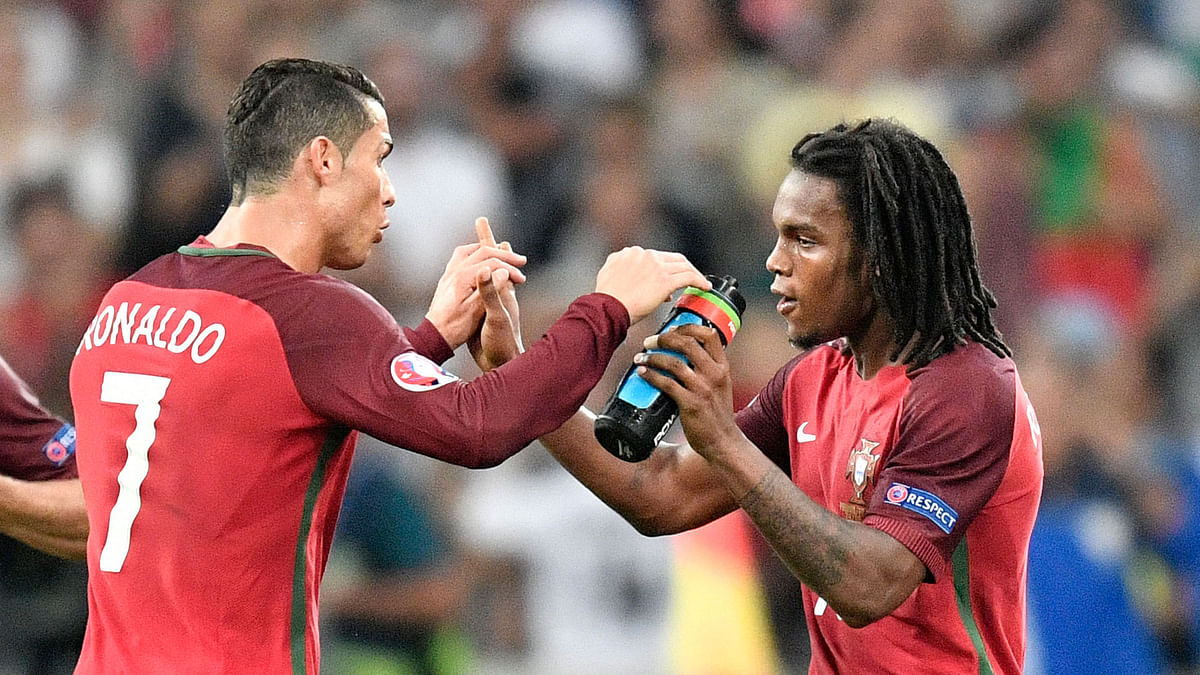 Portugal's Renato Sanches, right, celebrates with his teammate Cristiano Ronaldo, after scoring during the Euro 2016 quarterfinal match between Poland and Portugal. (Photo: AP)