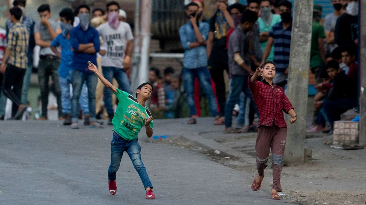 Young Kashmiri protesters throw bricks and rocks at Indian securitymen during a protest in Srinagar, Indian controlled Kashmir, Saturday, July 16, 2016. (Photo: AP)
