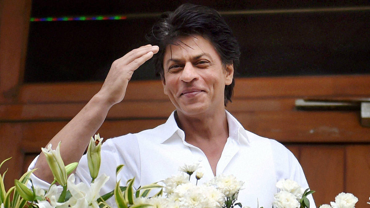 Actor Shah Rukh Khan waves to his fans. (Photo: PTI)