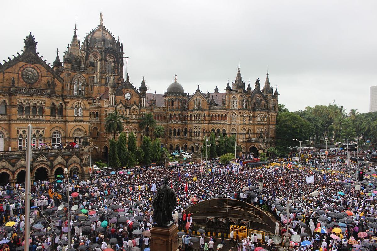 Thousands gather to protest Ambedkar Bhawan demolition outside the Chhatrapati Shivaji Terminus. (Photo: Ashish Dikshit)