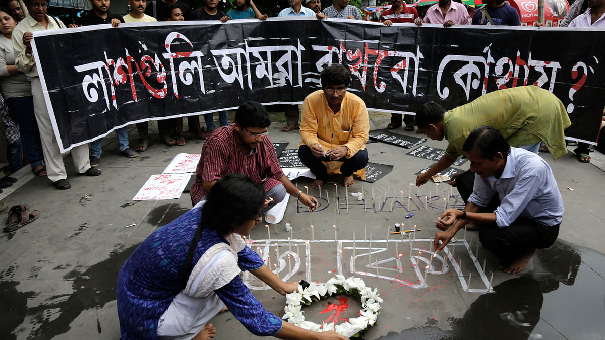 Indian activists participate in a candle light vigil protesting the Bangladesh restaurant attack, in Kolkata. (Photo: AP)