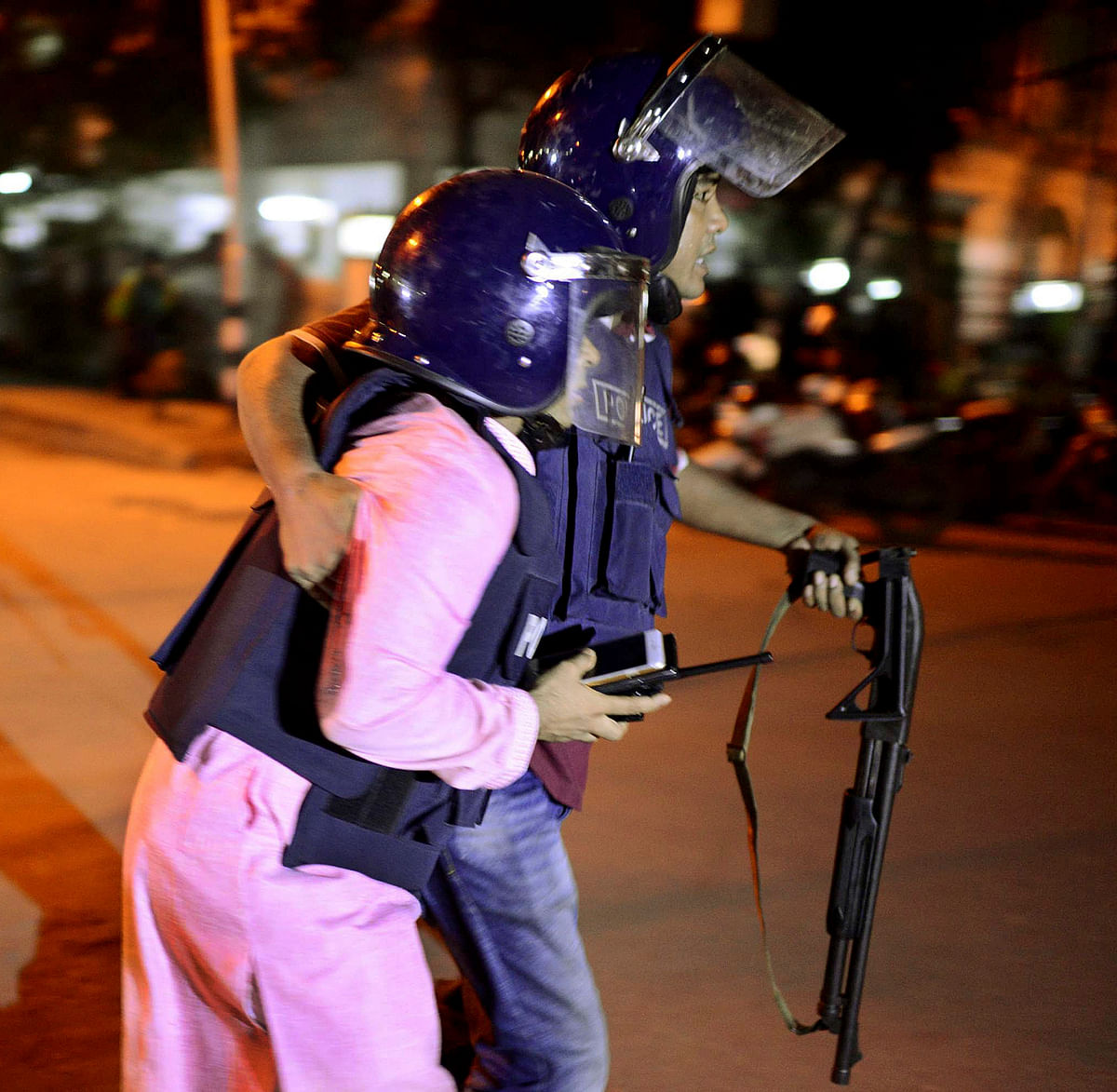 An unidentified security personnel is taken for medical attention. (Photo: AP)