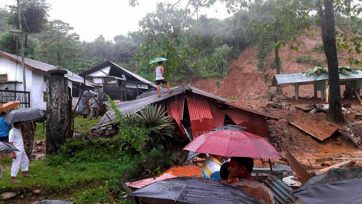 A damaged houses after landslide at upper Bhalukpung area of Arunachal Pradesh on Friday. (Photo: PTI)