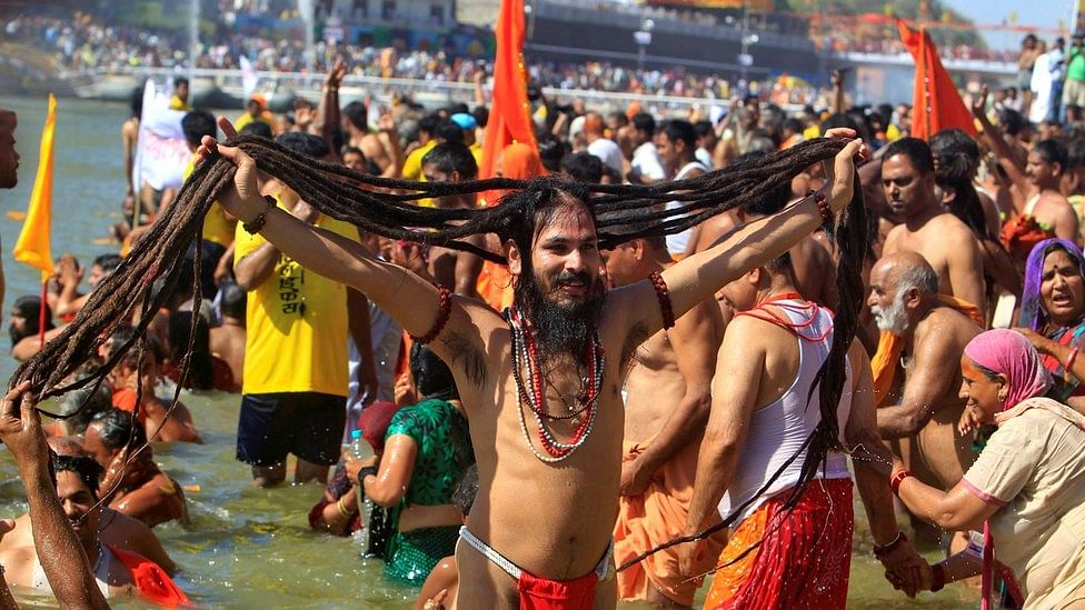 A holy man displays his hair after taking a dip in the River Kshipra during the Simhastha Kumbh Mela 2016, in Ujjain. (Photo: Reuters)