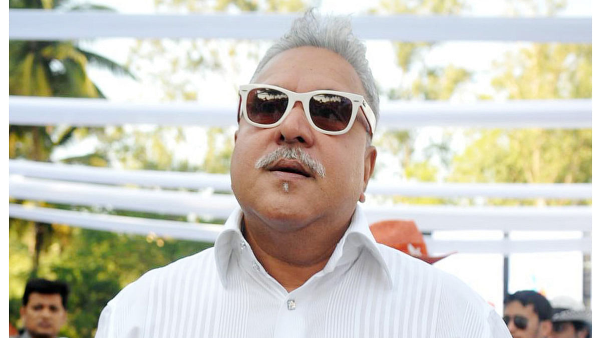 Vijay Mallya was recently seen cheering on his Force India team from the pit during the British Grand Prix. (Photo: IANS)