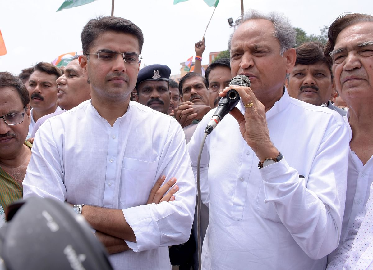 Sachin Pilot and former Rajasthan chief minister Ashok Gehlot participate in a demonstration against suspension of party MPs in Jaipur. (Photo: IANS)